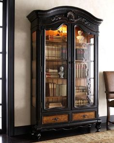Antique book cabinet. Also, the black base boards and wood trim might go well in a house with black trim windows.