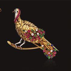 18 KARAT GOLD, COLORED STONE AND DIAMOND BIRD BROOCH, CIRCA 1955