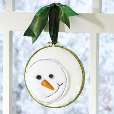 Hanging Snowman Craft Hang this smiling felt snowman in the window for an extra dose of holiday cheer. He comes together with felt and an embroidery hoop for a simple and sweet craft you can make in multiples.