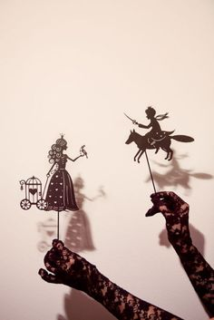 Fairytale shadow puppets. The lace gloves are PERFECT with them.