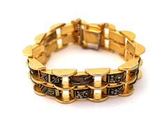 1950s Damascene Bracelet  This heavyweight, chunky damascene bracelet is circa 1950s-1960s. It's fully articulated, comprised of alternating sets of plain and detailed black stone links done in a traditional hand-painted scroll and rivet motif. It's a much heavier weight than one typically sees for this type of jewelry and has a thick and bright gold plate.  www.revivalcultvintage.com