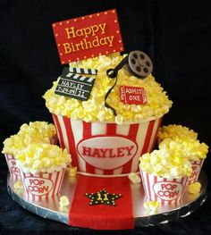 """Hollywood giant cupcake """"Popcorn"""" is hand shaped, spray painted marshmallows.  Fondant base, details, & decorations."""
