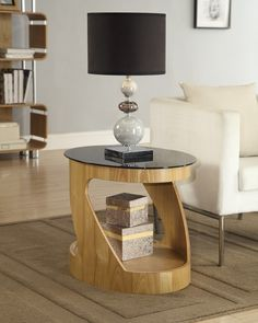 Jual Furnishings JF304 Oval Lamp / Side Table in Oak  This beautiful Lamp/Side Table combines Real Oak Veneer and Piano Black Glass to give it a luxurious finish.  This stunning table offers practicality and style. With is open space and storage for your every day items.