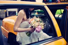 New York City Chic Wedding. The framing of the taxi door makes this photo so interesting
