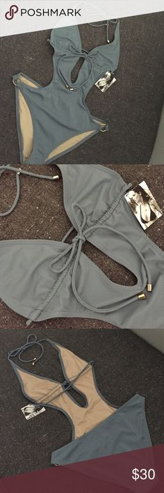 NWT Victoria's Secret Dusty Blue Monokini Medium Pretty dusty blue swimsuit from Victorias Secret. Size medium and NWT. Gold hardware. This beauty needs to see the sunshine! Please no trades. Victoria's Secret Swim One Pieces