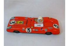 Vintage tin plate red Ferrari car with friction motor