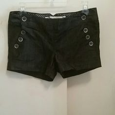 Dark Jean shorts Dark jean shorts, size 7. Has pockets with button detailing ! Shorts Jean Shorts