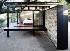 Nestled into the edge of a cliff in a suburb of Johannesburg, South Africa, the Westcliff Pavilion residence is built from steel, glass and stone and appears to hover above the ground. Designed by GASS Architecture Studio to make the most of the city views, the steel framed house comes complete with one side that\'s mostly glass and a floating stone wall.
