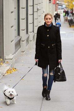 The Olivia Palermo Lookbook Haha this must be the happiest dog in the world! Olivia Palermo wearing a black military coat with ripped skinny jeans, a black doctors bag and black ankle boots. Visit www.ofvogueandrestraint.wordpress.com for tips on how to revamp and upgrade your wardrobe.