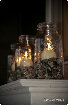 Mason jar, rocks & ball candle -- this would be cute with seashells too.