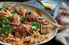 Chicken W/ Caramelized Onion & Cardamom Rice. Currants, cloves, cinnamon, dill, cilantro, Greek yogurt. Jerusalem. NY Times