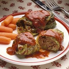 Turn to this old-fashioned favorite when you're looking for a ground beef dinner. Wrap cabbage leaves around a ground beef mixture, smother in spaghetti sauce, and bake. #foods #recipes