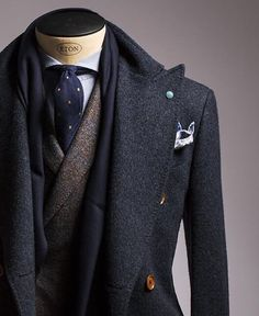 Light blue shirt, dark spotted necktie, brown jacket & a pea coat with scarf. Great outfit for winter.