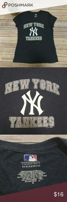 New York Yankees heather blue and silver t-shirt New York Yankees t-shirt in a dark heather blue.  It has a white Yankees logo and white and glittery silver lettering on the front.   Pet free smoke free home. Tops Tees - Short Sleeve