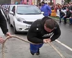 WOW this is strong!!! Man Pulls 12 #Nissans To Break The World Record For Most Cars Pulled. You Gotta Watch This...