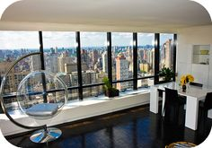 Home of the week in New York City (located on the 46th floor).  The apartment is pristine white and incredibly neat and tidy. With a large window on one side of the room, you can lay in bed whilst enjoying the spectacular skyline or looking down onto Central Park. (this two-bed apartment available for both swapping and renting.)