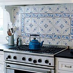 This back splash tile was hand-painted by a local artist and ties in with a blue pantry, which is built-in around the corner in the mudroom. Check out the whole house @This Old House.com.   Photo: Laura Moss   thisoldhouse.com