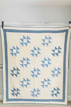 Antique blue and white traditional quilt made with half square triangles