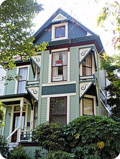 Green Queen Anne Victorian house, front view by eg2006, via Flickr