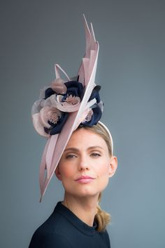 Handcrafted in our London studio.Sinamay disc with handmade silk flowers.Secured with a hairband and comb. Colour: Pink/Navy.Please enquire if you would like this made in a bespoke colour.Secured with a hairband and comb.1 in stock, delivered in 3-5 business days.Sent free within the UK. Includes a Black