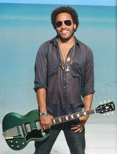 Lenny Kravitz--love this of him because you rarely see a smile in a picture