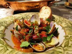 Recipe by Paula. A Cataplana is a Portuguese cooking vessel that is traditionally made of copper and is shaped like two domed clam shells. Portuguese Cataplana Recipe, Portuguese Recipes, Portugal, Clams, Seafood Recipes, Baked Potato, Clam Shells, Favorite Recipes, Fish