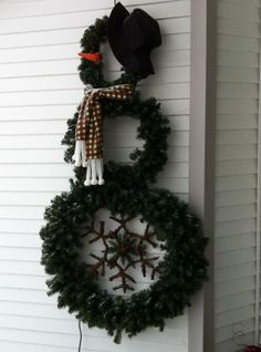 My wreath snowman...he also has 175 mini lights on him, but the photo was taken during the day.