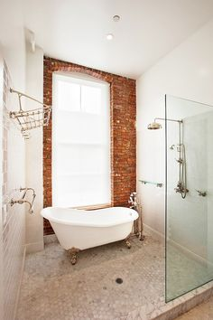 This is the kind of bathroom I'm determined to have. Shower and bathtub in a glassed enclosure.