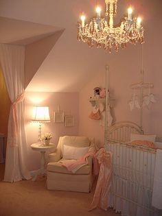 I love the lighting and feel of this nursery. Love the chandelier!