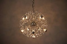 Italian Chrome-Plated Firework Sputnik Chandelier   From a unique collection of antique and modern chandeliers and pendants  at https://www.1stdibs.com/furniture/lighting/chandeliers-pendant-lights/