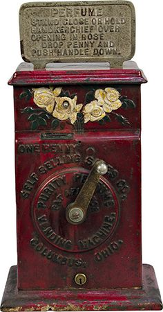 """1 Cent Self Selling Sales Co. """"Purity Perfume Vending Machine"""" Perfume Sprayer c1910, cast-iron case. The perfume is sprayed out of the embossed roses at the top of the machine, in excellent original condition, rare w/ keys - 7""""w x 5""""d x 14""""h"""