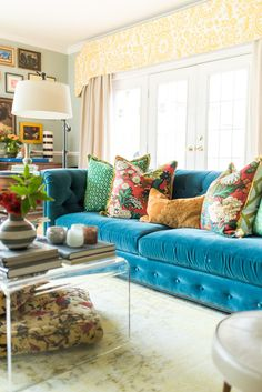 If I don't say this often enough, I absolutely love re-designing living rooms. It's where we spend the majority of our time, that . Bold Living Room, Living Room Orange, Cottage Living Rooms, Living Room Paint, Living Room Sofa, Living Room Decor, Cozy Living, Teal Couch, Cool Rooms