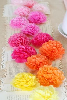 fun party table runner -- book pages & tissue flowers // lisa storms
