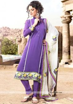 Simple and sober pattern elegant purple suit with high collar neck. Beautiful embroidered contrast patch looks attractive. It will look good for office and formal parties. http://goodbells.com/salwar-suits/simple-and-sober-purple-salwar-kameez.html