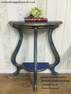 Solid reproduction demi lune, painted in layers of Annie Sloan Chalk Paint Napoleonic Blue, Provence, Duck Egg Blue, and English Yellow, distressed, sealed with clear wax, and highlighted with gold leaf Rub 'n Buff.