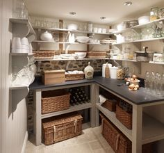 Chalon Pantry.  This is so rustic and refined.  Antique ironstone, baskets, but mine would have etched crystal and sterling silver platters