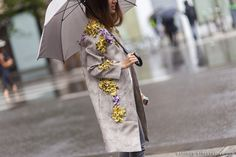Naturals. Grey/Beige Coat with Yellow and Purple Flowers. Street Style. Fashion Week.