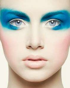 I love that color and the face. What is the first thing you see when you look at her? The pale face, or the incredibly crazy blue makeup?