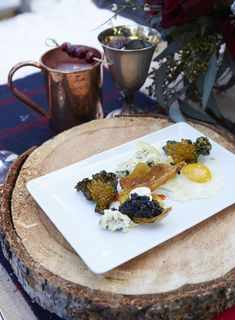 """Winter is a time for comfort foods and culinary alchemy, like dining on crisp potato skins with quail eggs, kale chips and gribiche. Executive Chef Josh Drage's delectable recipe is featured in the Relais & Châteaux book """"The Art of Entertaining."""" Photo by David Engelhardt."""