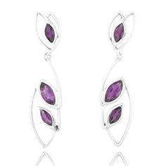 Top up your fashion statement with these hot purple african amethyst marquise danglers in trendy silver frame just for $ 21.18, € 16.76, £ 13.21, INR 1299 code de1568ame visit us at www.metallierjewellery.com