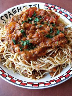Easy Meat Sauce for Pasta- Crushed tomatoes, onions, garlic, and lots of ground beef combine in this easy meat sauce that freezes well, so you can enjoy it any time!