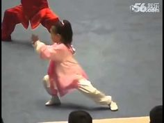 Little Girl Zhang Yuting performs a Chen Tai Chi competition form along with other children.