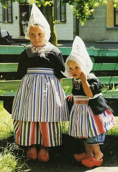 Two Dutch girls in traditional costumes, Holland. I had to wear this in both Miss Universe Pageant and The Miss World. hahaha