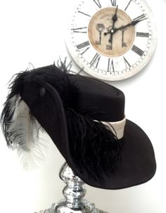 Black leather Cavalier hat with Ivory taffeta band, gunmetal coat of arms buttons and detachable full feathered black and Ivory ostrich plumes.  Made in my own workshop in Scotland  https://www.etsy.com/uk/shop/Blackpin?ref=hdr_shop_menu | Shop this product here: spree.to/a3n4 | Shop all of our products at http://spreesy.com/JewelsByScarlett    | Pinterest selling powered by Spreesy.com
