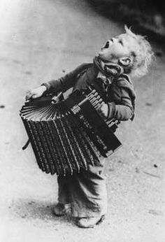 SHARED BY RALEIGH DeGEER AMYX - CIRCA 1920 - A YOUNG LAD WITH HIS ACCORDION SINGING ALOUD FOR ALL HE IS WORTH -