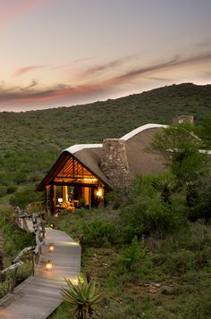 Kwandwe Fish River Lodge is one of four lodges situated within the 22 000-hectare Kwandwe Private Game Reserve, South Africa. Set on a bushy gorge overlooking the Great Fish River, the lodge has sweeping views of the river and the hills beyond it. If you are looking for a safari holiday with stylish accommodation then Kwandwe Fish River Lodge is top of the chart. Timbuktu Travel. Beautiful Homes, Beautiful Places, Chic Beach House, Thatched House, Game Lodge, River Lodge, Weekend House, Hotels And Resorts, Lodges