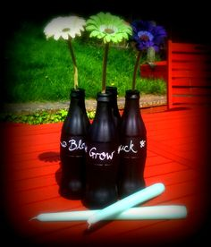 I snagged some of the OH's empty glass coke bottles and used some chalkboard paint to cover them. Voila! Outdoor vases or candle holders that you can personalise!
