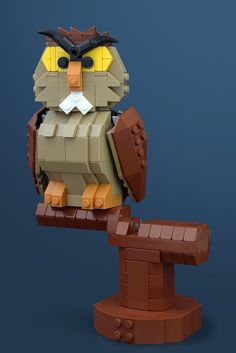 Golly fluff – Archimedes the owl in LEGO form Archimedes Owl from The Sword and the Stone. Lego Kits, Lego Design, Lego Disney, Disney Fun, Lego Duplo, Lego Moc, Construction Lego, Lego Sculptures, Amazing Lego Creations