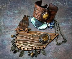 SALE! Discounted tooled leather Boho jewelry set with tiger eye - 77.77$ #tooledleather #leathercraft #leather #tigereye #pendant #bronze #handmade  #iridescent #fantasy #jewelry #jewellery #gemstones #Gemsplusleather #art #artisan #rustic #boho  #handcarved #wooden #bracelet #cuff #jewelryset #necklace