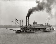 America, Mississippi riverboat, circa 1900-1910. Note the group of convicts in prison stripes.